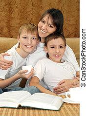 Beautiful charming mama and sons sitting
