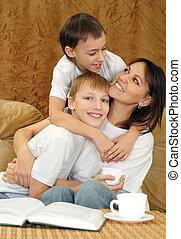 Beautiful charming mummy and sons sitting