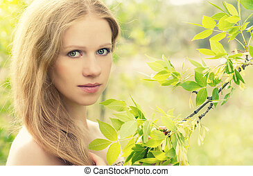 Beautiful charming mysterious girl in the forest on the nature