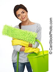Beautiful cheerful brunette woman in gloves with mop and...