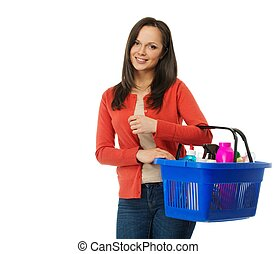 Beautiful cheerful brunette woman with basket full of...