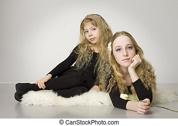 Beautiful child and teen girl with white rose