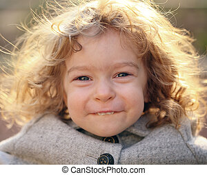 Closeup portrait of beautiful child outdoors