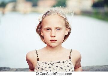 Beautiful child girl outdoors portrait