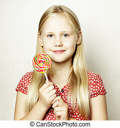 Beautiful child girl with colorful lollipop