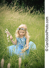 beautiful child in the meadow