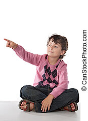 Beautiful child pointing with his finger sitting on a over...