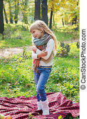 Beautiful child stands in a scarf