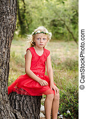 beautiful child waiting in forrest
