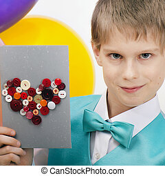 Beautiful child with postcard