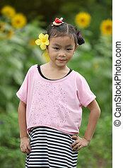 Beautiful child with sunflower