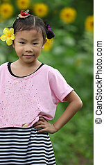 Beautiful child with sunflower