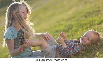 Beautiful children playing on green grassy field