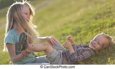 Beautiful children playing on green grassy field