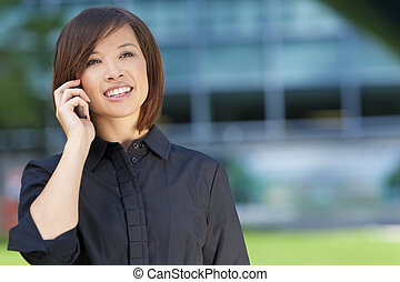 Beautiful Chinese Asian Woman On Her Cell Phone