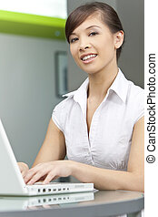 Beautiful Chinese Asian Woman Using A Laptop Computer