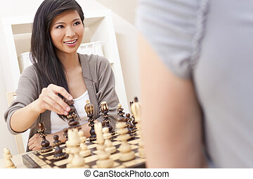 Beautiful Chinese Oriental Asian Woman Playing Chess