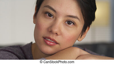 Beautiful Chinese woman looking at camera