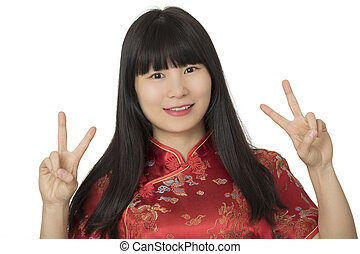 Beautiful Chinese woman wearing a Chipao isolated on white background