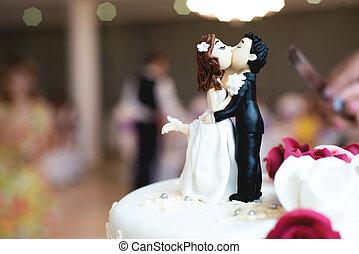 Beautiful chocolate figurines on top of wedding cake