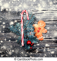 Beautiful Christmas background with gingerbread cookie, holiday decorations and snow, copy space