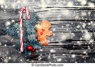 Beautiful Christmas background with gingerbread cookie,creativ  holiday decorations and snow, copy space