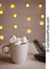 beautiful Christmas background with marshmallows in a white Cup