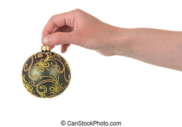 Beautiful Christmas ball with a gold-painted in hand isolated on white