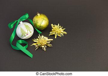 Beautiful christmas balls with green ribbon