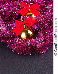 Gold Christmas balls and bright sparkling golden tinsel with red bows