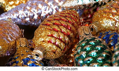 Beautiful Christmas decorations in form of colorful cones sprinkled with sparkles