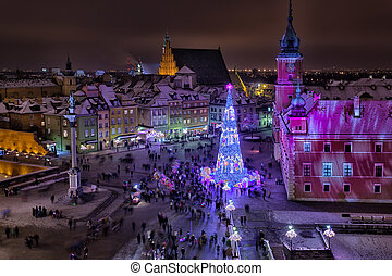 Beautiful Christmas fir-tree on Palace Square of Warsaw in the evening, the top view