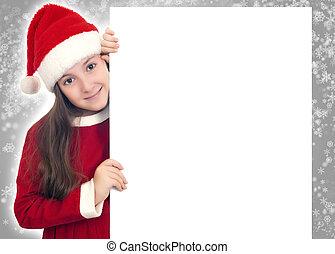 Beautiful Christmas girl holding blank sign board