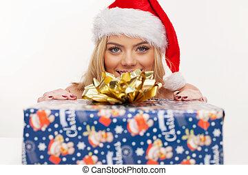 Beautiful christmas girl with gift box