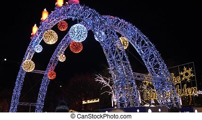 Beautiful Christmas lights , city decoration at nigh time in Austria Vienna entrance to fair market at City Hall