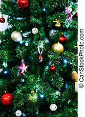 Beautiful Christmas toys on the branches of a Christmas tree.