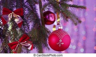 beautiful Christmas tree decorated with colorful baubles -...