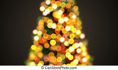 Beautiful Christmas Tree Lights Flickering in Defocused Blur Bokeh. Greeting Background Seamless 3d Animation. Merry Christmas and Happy New Year Celebration Concept. 4k Ultra HD 3840x2160