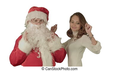 Beautiful christmas woman dancing with Santa Claus on white background