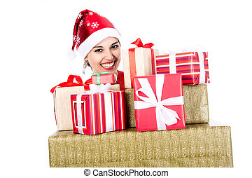 Beautiful christmas woman is holding gift in studio