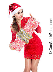 Beautiful christmas woman is holding gift