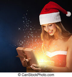 Beautiful christmas woman open fairy gift