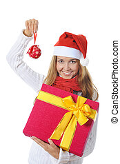 Beautiful christmas woman with a gift