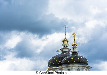 Beautiful church domes with gold crosses against a cloudy...
