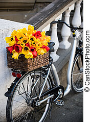 city bike with a bouquet of flowers