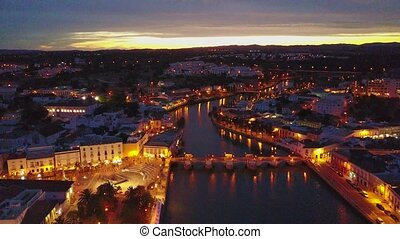 Beautiful city center of Tavira by Gilao river at night from...