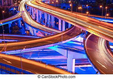 closeup of the beautiful city interchange overpass at night