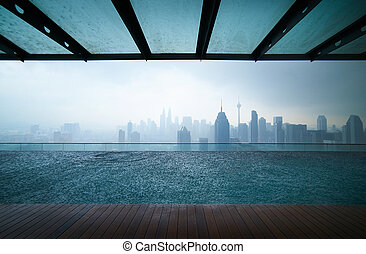 Beautiful city skyline - Swimming pool on roof top with...