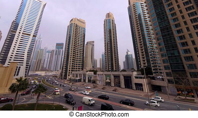 beautiful city time lapse of skyscrapers, roads and cars in Dubai, UAE