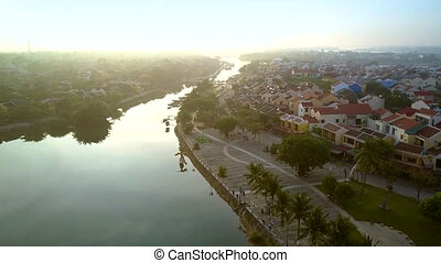 beautiful cityscape with calm river meandering to horizon